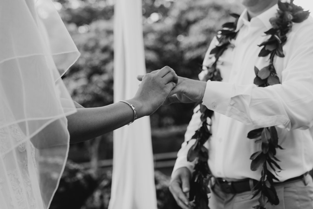 Exchange of wedding rings at Kualoa Ranch Paliku Gardens. Photography by Hawaii wedding photographer Desiree Leilani