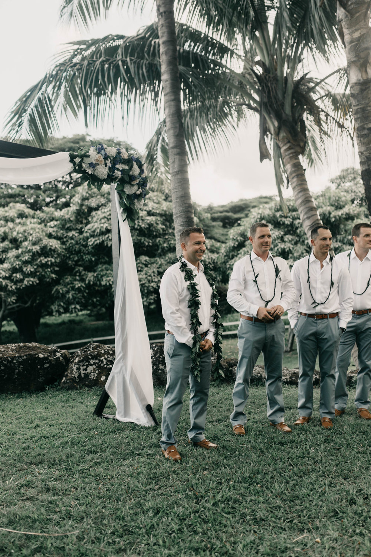 Groom's reaction seeing his bride walk down the aisle at Kualoa Ranch Paliku Gardens. Photography by Hawaii wedding photographer Desiree Leilani