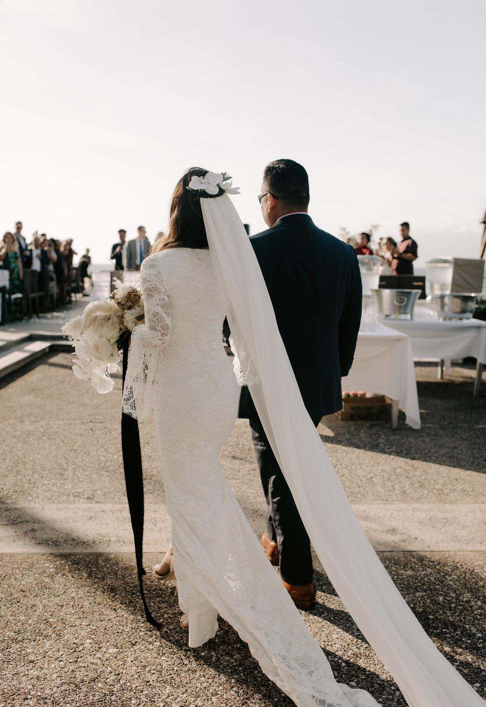 Father walking bride down the aisle | Merriman's Kapalua Maui wedding by Hawaii wedding photographer Desiree Leilani
