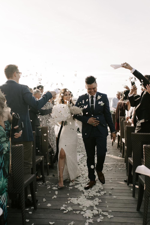 Flower petal exit | Merriman's Kapalua Maui wedding by Hawaii wedding photographer Desiree Leilani