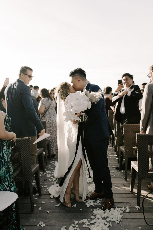 End of the aisle kiss | Merriman's Kapalua Maui wedding by Hawaii wedding photographer Desiree Leilani