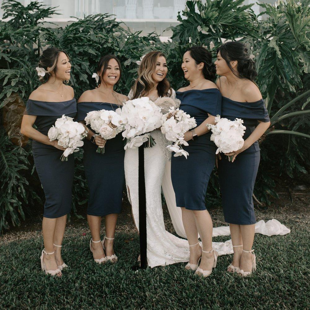 Bridesmaids laughing photo | Merriman's Kapalua Maui wedding by Hawaii wedding photographer Desiree Leilani