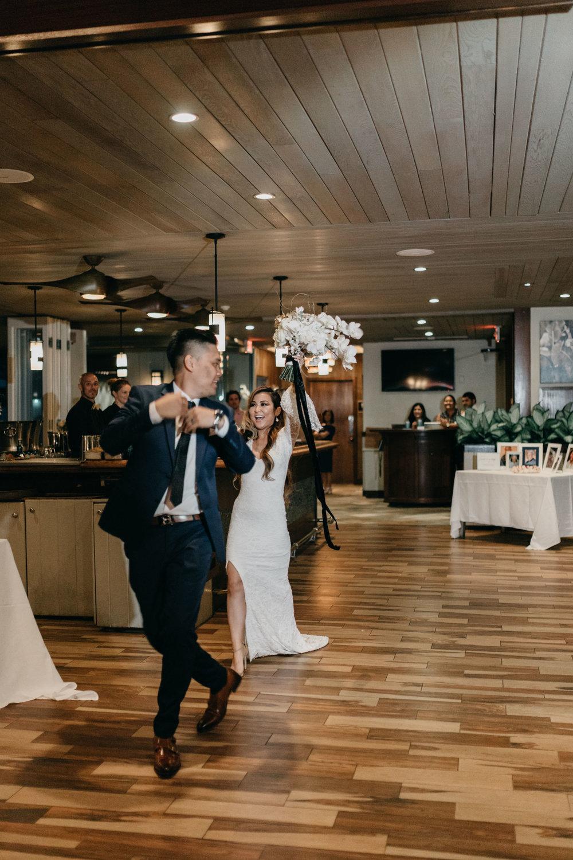 Bride and groom grand entrance | Merriman's Kapalua Maui wedding by Hawaii wedding photographer Desiree Leilani