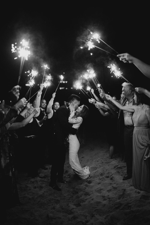 Sparkler exit at Merriman's Maui Kapalua Bay by Hawaii wedding photographer Desiree Leilani