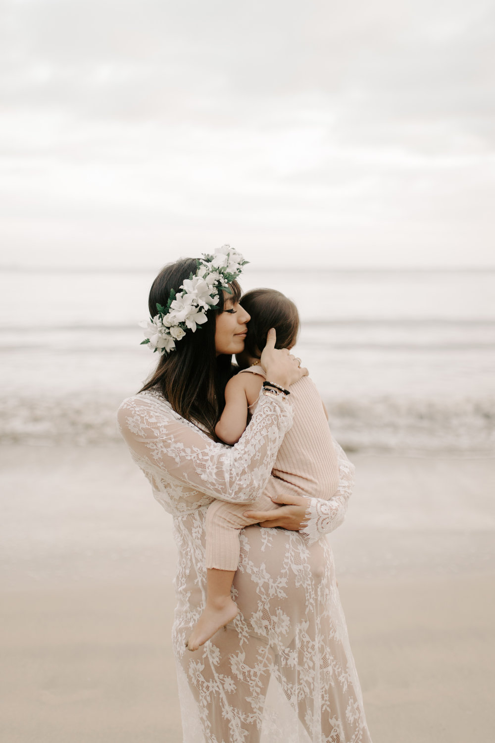 Beautiful moment between a mother and her daughter at Kahana Bay by Oahu Maternity Photographer Desiree Leilani