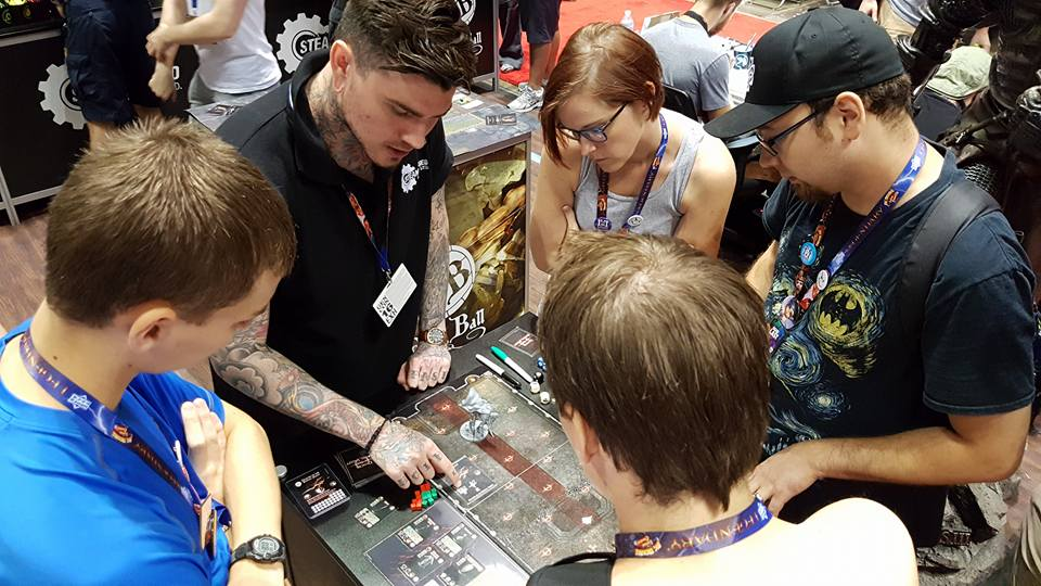 You can even demo Dark Souls—The Board Game like these attendees from GenCon!