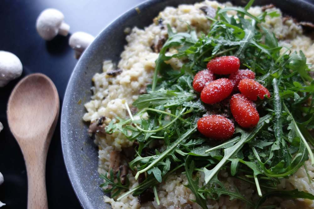Serve the mushroom leek risotto with a rocket, cherry tomato and olive oil salad on top.