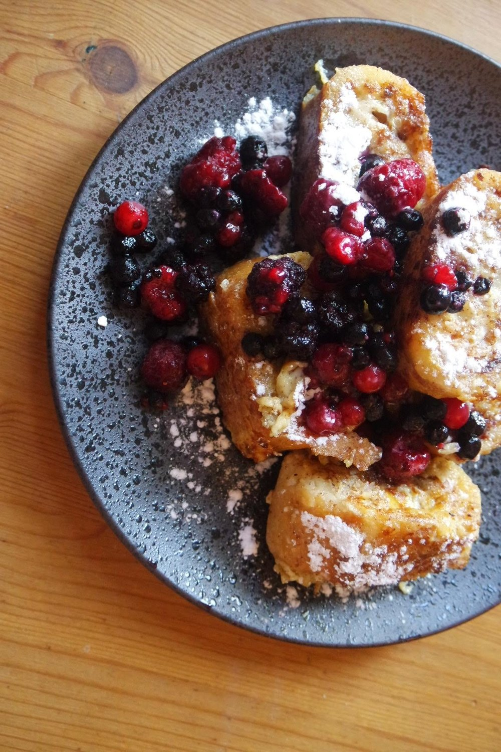 French toast, known in France as pain perdu (literally 'lost bread') topped with warm berries.