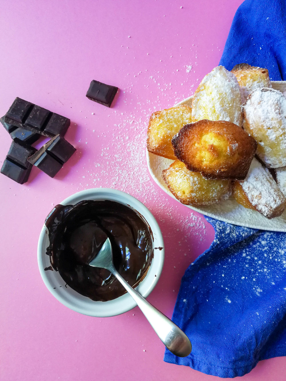 An alternative: dip the madeleines in melted chocolate. Let them resolidify before serving.