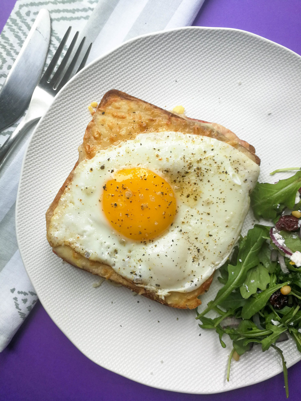 The croque madame: a grilled ham and cheese sandwich with two layers of bechamel sauce and a fried egg on top. That yolk, huh?