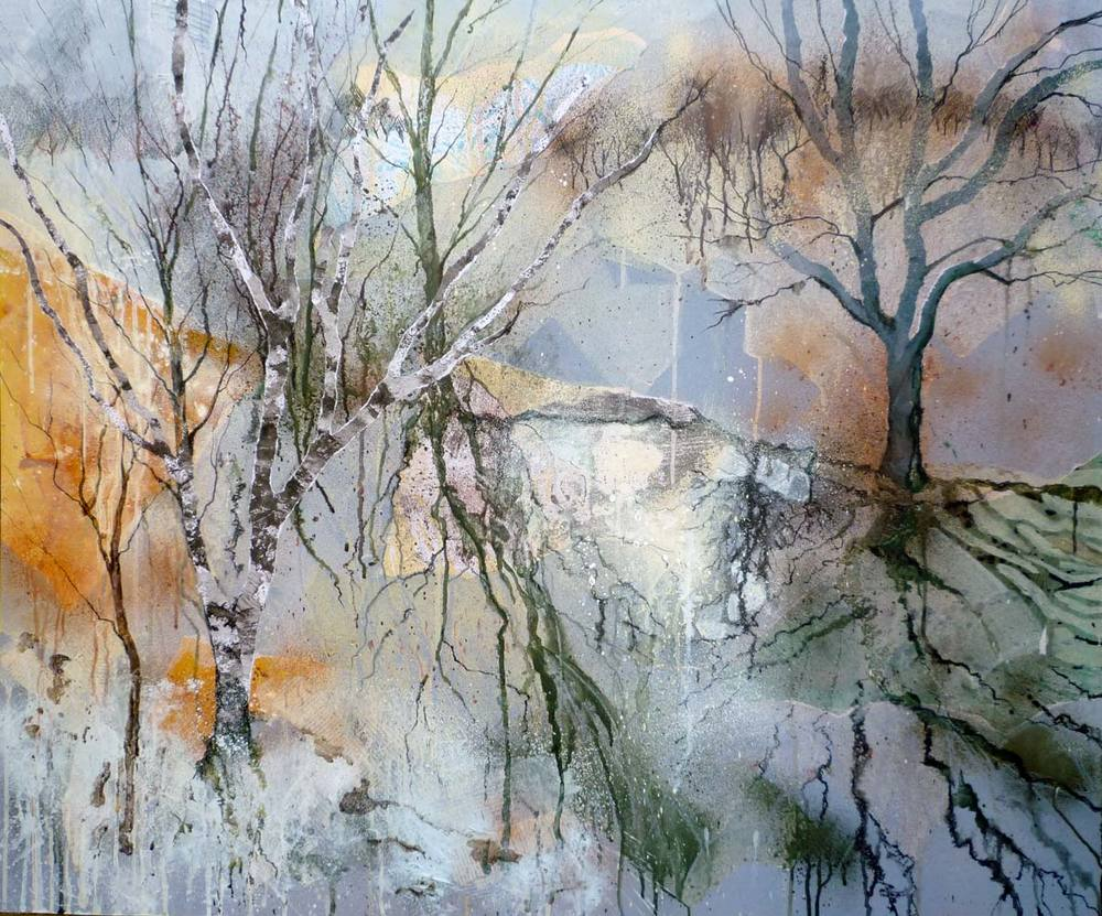 Winter trees reflected in the brook
