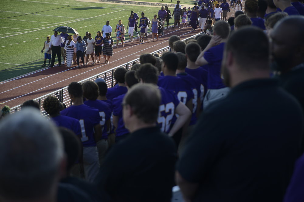 Friends and family of the late Hickman High School football coach Arnel Monroe enter his memorial service at Alumni Stadium on Hickman's campus on Thursday, June 9, 2016. Before coaching, Monroe worked as a special education teacher at the school since 1993.