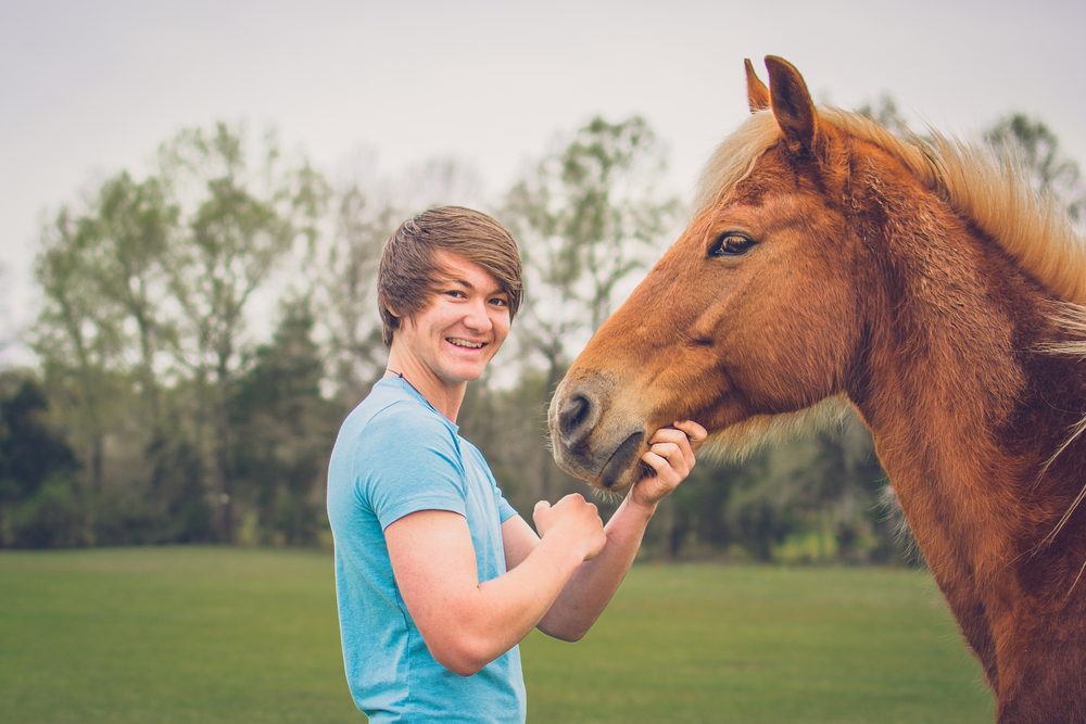 Ty with his horse, Red.
