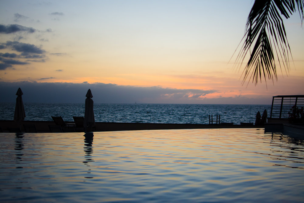 A great view overlooking the ocean from the heated water of the family pool.