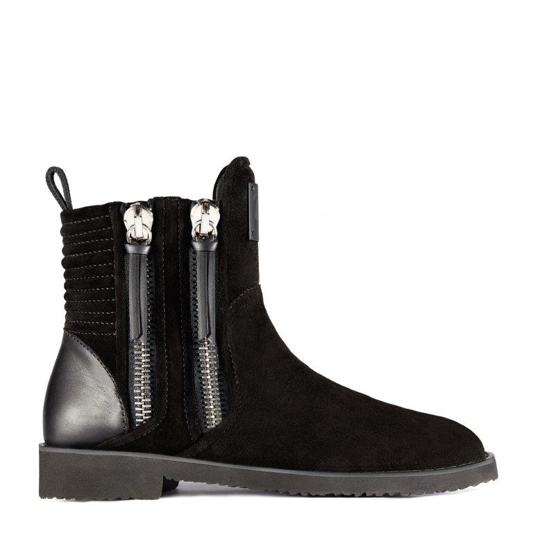 ZIGI: A modern take on the Chelsea boot in black suede with leather details and metallic double side zips.