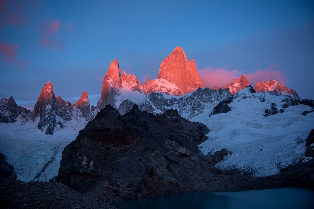 The picturesque Fitz Roy at sunrise with Laguna De Los Tres and glacier below