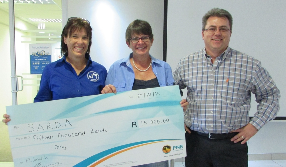 SARDA representatives receive a charitable contribution from raised golf day proceeds