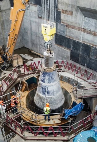 CONE IS LOWERED AFTER RELOCATING THE CRUSHER