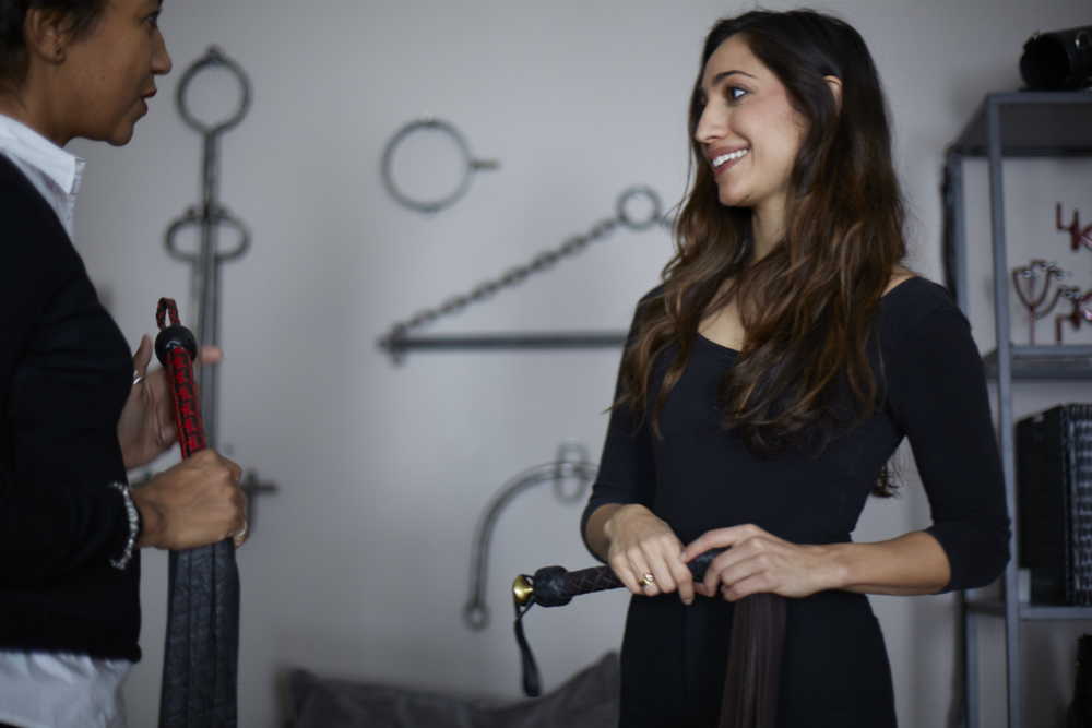 Olivia Troy, left,explains whip technique to an actor at the Kink On Set studio.