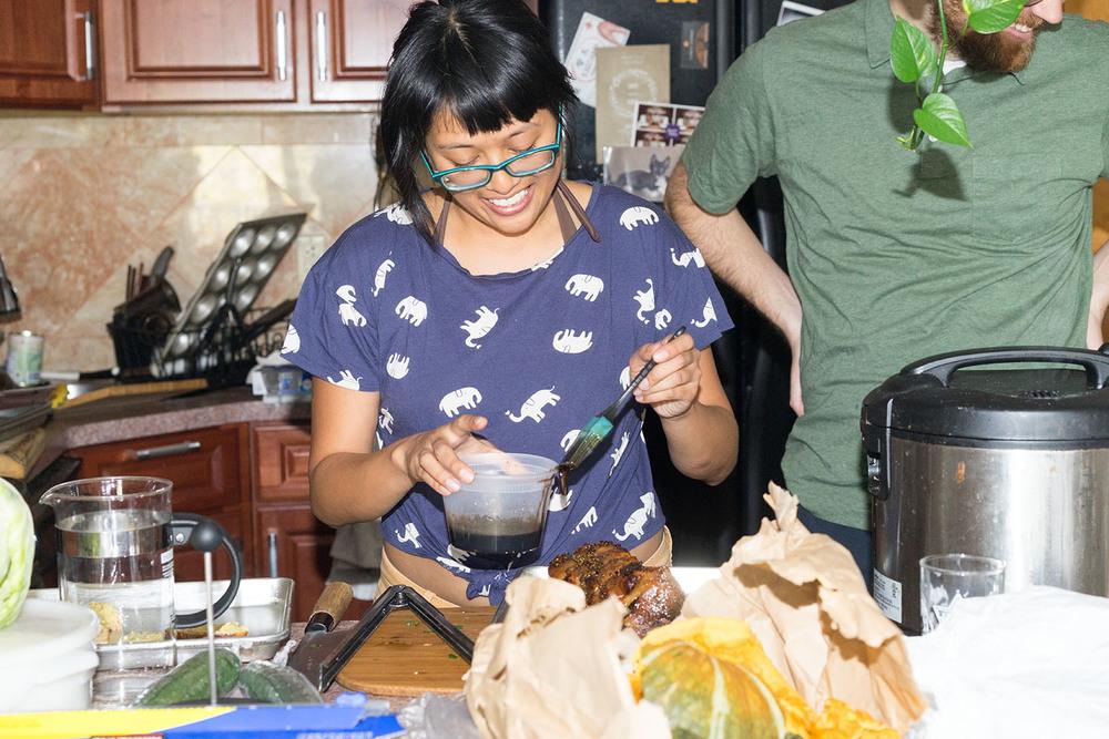 Jenn de la Vega basting her pork.