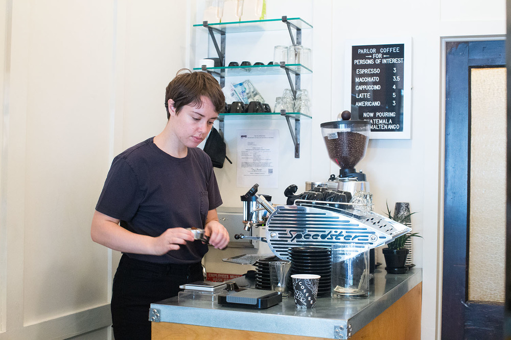 Claire, a barista at Parlor Coffee, makes us an Americano. Parlor Coffee is roasted in nearby Bedford-Stuyvesant. Parlor Coffee at Persons of Interest, 84 Havemeyer Street, Brooklyn.