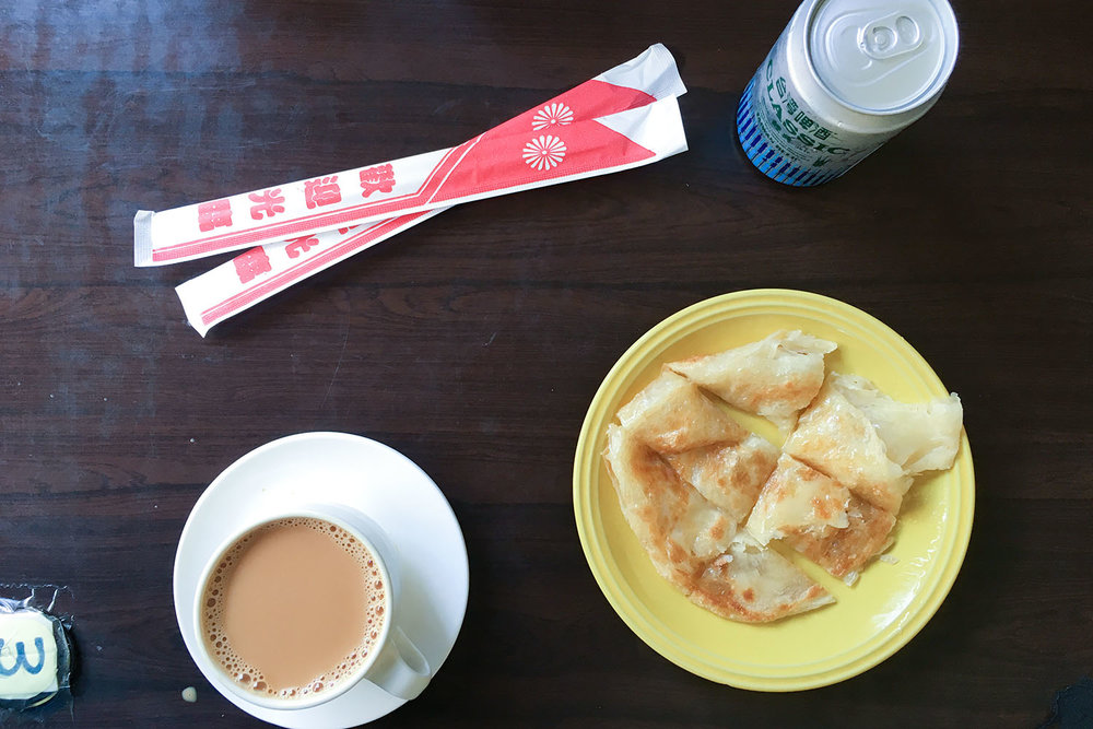 Milk tea and paratha glazed with condensed milk in Little Burma, Nanshijiao, Taipei. And a Taiwan beer.