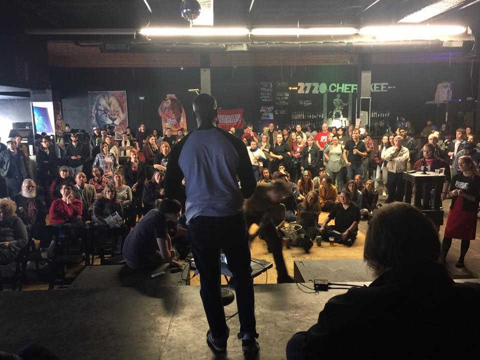 "Mass ""resistance"" meeting organized by Socialist Alternative St. Louis. Sunni Hutton, Adam Turl, Ashton Rome, Sarah de Lacie. Photograph by Richard Reilly (2017)"