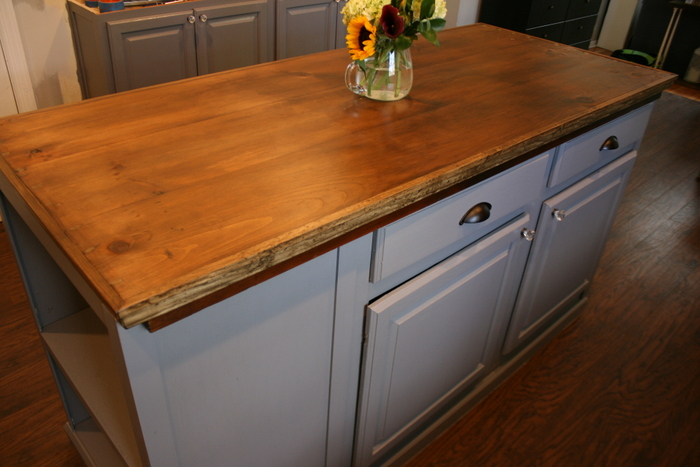 http://www.rootsandwingsfurniture.com/blog/kitchenisland