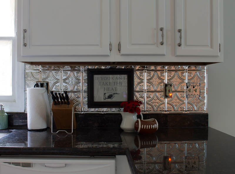 http://www.rootsandwingsfurniture.com/blog/tinbacksplash