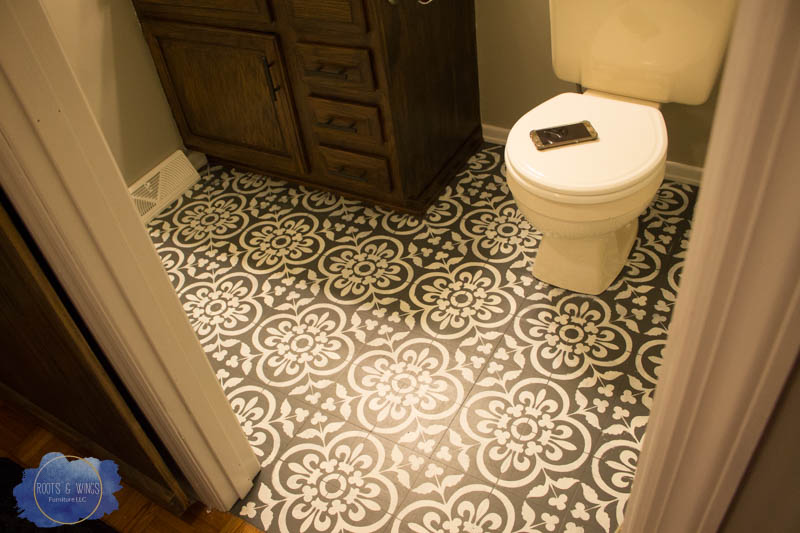 http://www.rootsandwingsfurniture.com/blog/paintedfloor