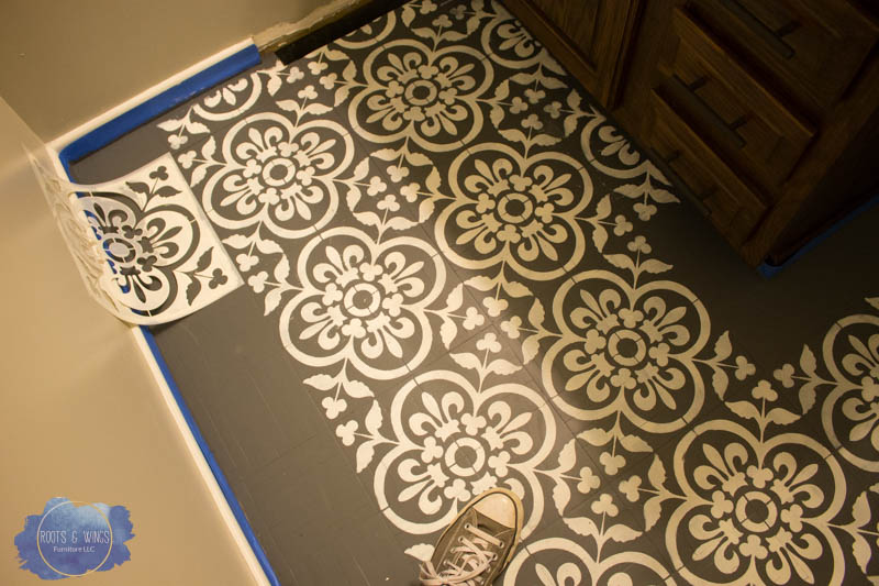http://www.rootsandwingsfurniture.com/blog/paintedfloor
