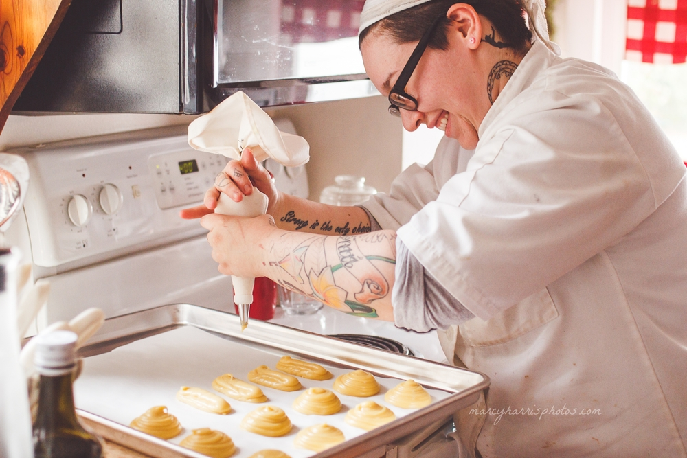 Ohio Birth & Life Photography | Marcy Harris Photos | Woman baking in chefs coat smiling