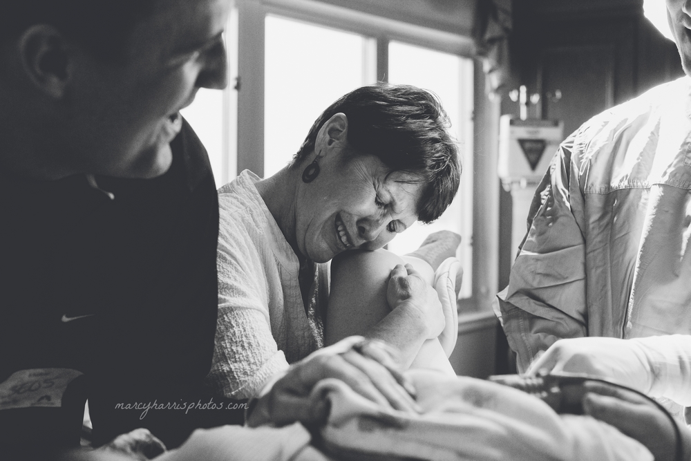 """""""When the surprise announcement of the baby's gender was exclaimed by the doctor, everyone jumped up and down cheering 'It's a boy!' and this mother wept and looked toward her daughter, also a mother — now of a son, with the most adoration and love possible."""""""