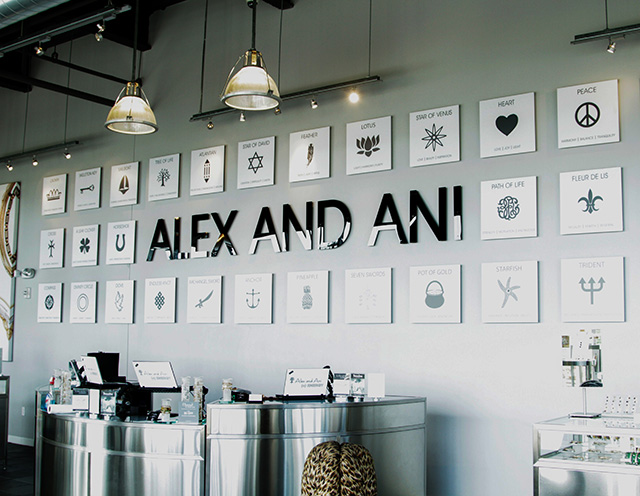 Alex and Ani bartenders use a symbol wall like this one to start a conversation with a customer and help them find something meaningful.