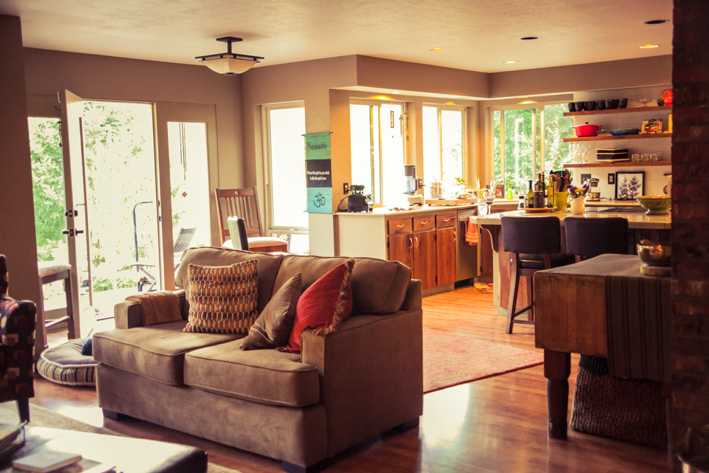 Cozy common space: kitchen and wood burning stove family room.