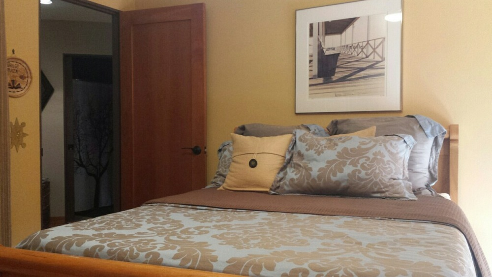 The Lotus Room: private space, tempurpedic double bed.