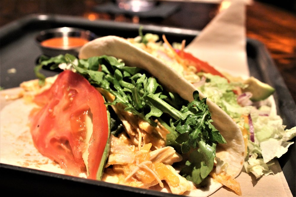 The Roasted Chicken Taco features pulled chicken breast and the freshest arugula. The aioli sauce adds just the right touch to the taco.   The Fish Tempura taco features a light flaky tempura battered white fish.