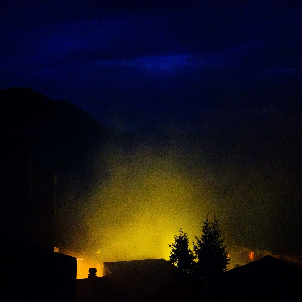 firework smoke consumes the town on August 1 to celebrate Swiss National Day.
