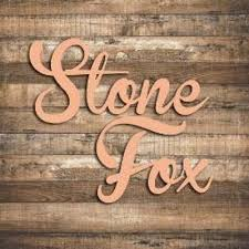 "Stone Fox Salon.  ""Our Specialty: Making you the most beautiful woman in the room."""