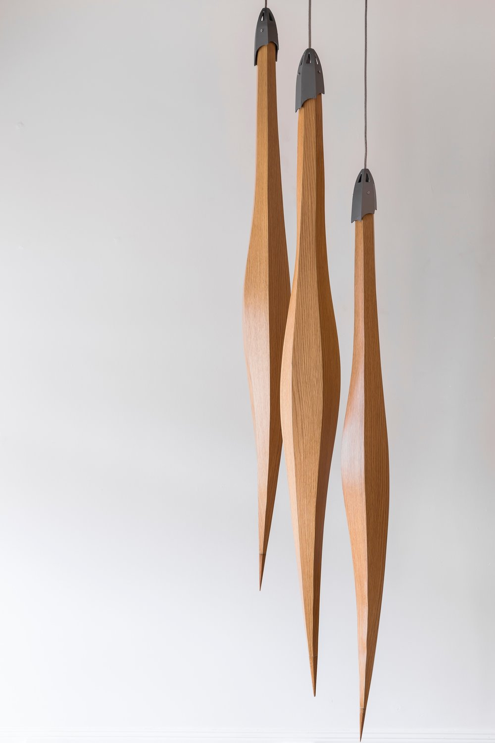 Harakeke Pods Materials: Macrocarpa / Oak / Custom - aluminium castings Size - H 1800mm                                                Light Source: High CRI LED strip Please enquire for price Handcrafted in New Zealand.