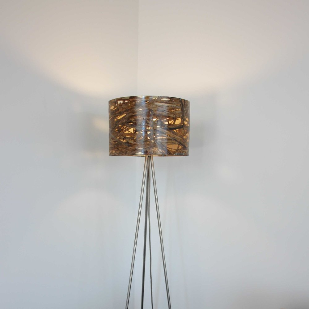 Envy standard lamp  Materials: Ti Kouka Leaf / Carbon Fibre - Stainless steel stand Size: 1800mm H Light source: x1 LED Bulb Enquire for price  Handcrafted in New Zealand