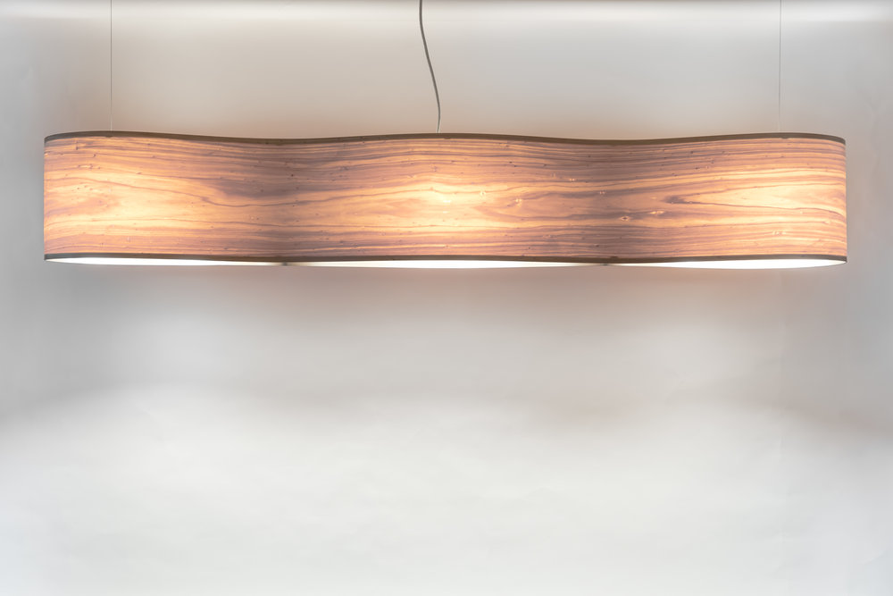 Infinity 1.8m Materials: Macrocarpa / Oak / Carbon Fibre Size: 1800mm L / 280mm H / 250mm W Light source: x3 LED bulbs Enquire for price Hand crafted in New Zealand