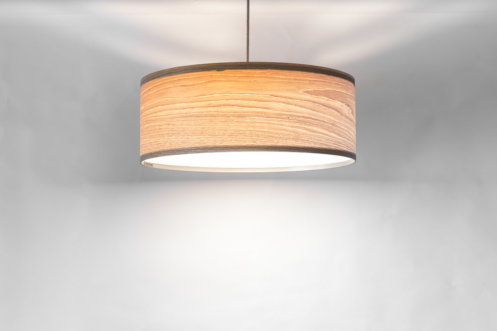 Yolk Pendant Materials: Macrocarpa / Oak / Carbon Fibre veneer Size: Multiple Sizes available Light Source: x3 LED Bulb harness Enquire for price Handcrafted in New Zealand