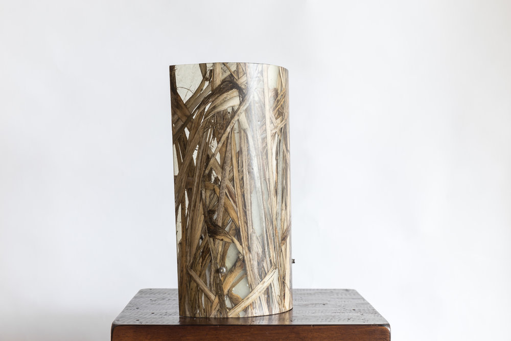 Ra 1 Wall Light   Materials: Ti Kouka Leaf / Macrocarpa / Oak / Kevlar / Carbon Fibre veneer, Aluminium castings  Size: 280mm H / 155mm W Light Source: x1 LED Bulb  Enquire for price  Handcrafted in New Zealand