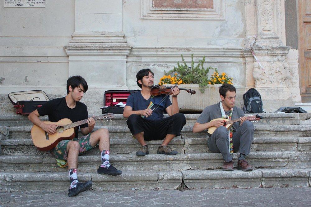 The company musicians prepare for opening night in Pezzolo
