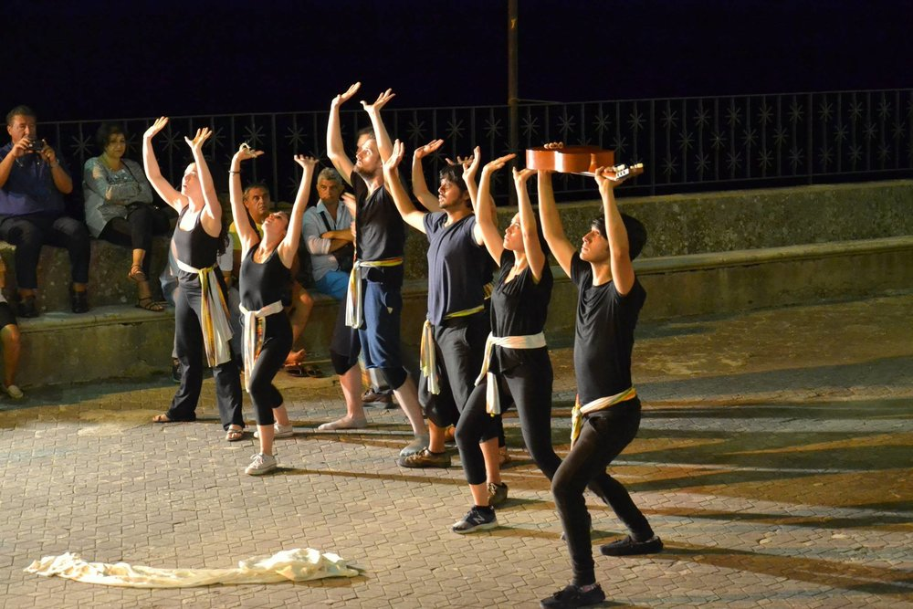Company members perform in the piazza San Nicolò di Bari in Pezzolo