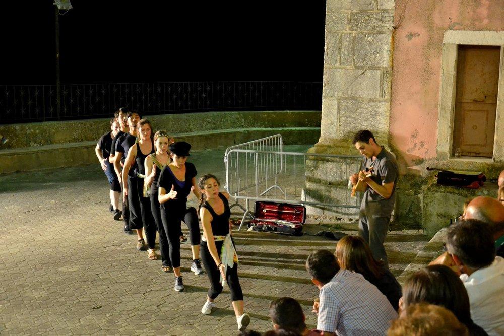 Company members perform in the piazza San Nicolò di Bari in Pezzolo