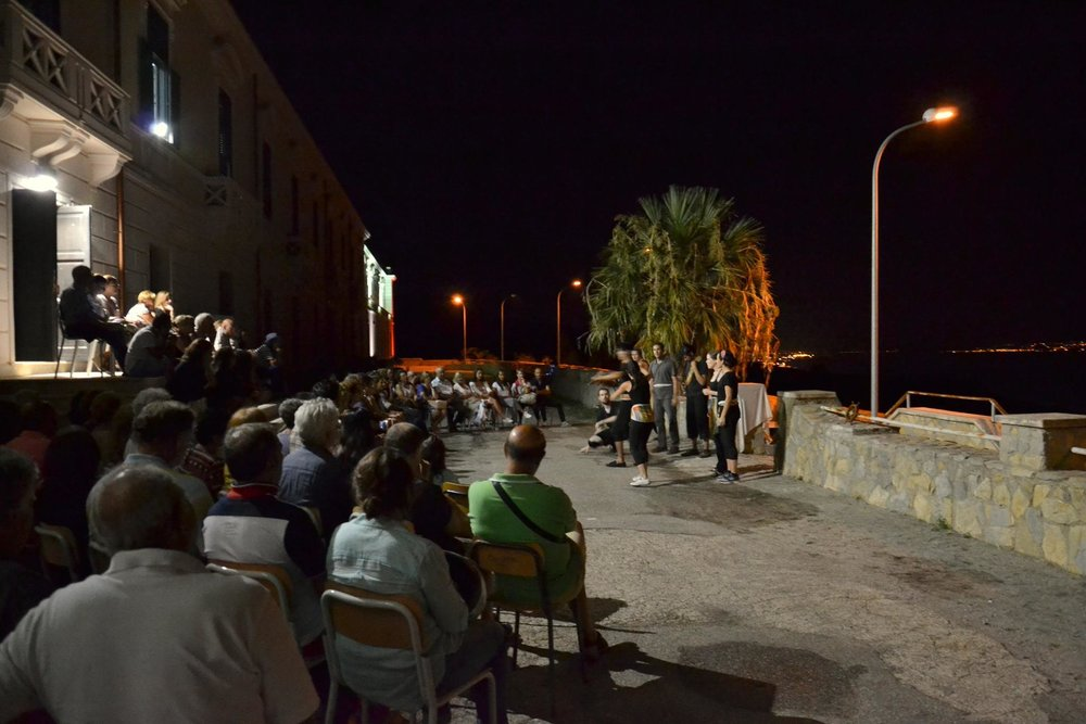 Company members perform in front of San Placido Calonerò