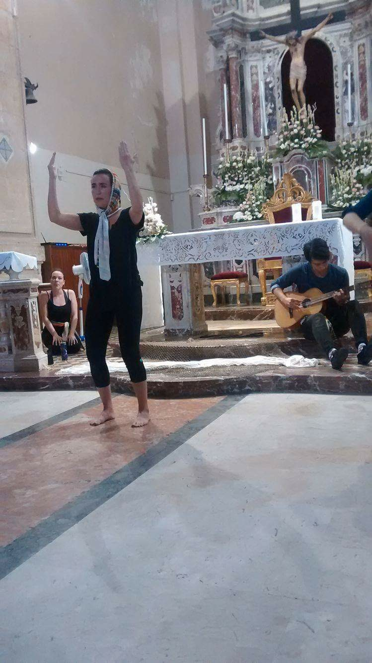 Company member Kathleen Lewis performs in the church of S. Giovanni in Santo Stefano di Briga