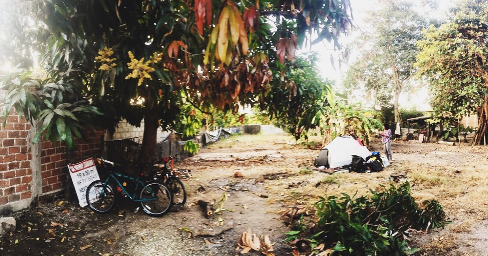 Our campsite in Santa Rita – a vacant lot, surrounded by mango and coconut trees!